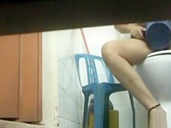 Asian slut caught peeing