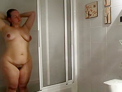 Wife takes shower and dries her curvilinear body
