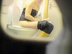 Blonde spied peeing in toilet