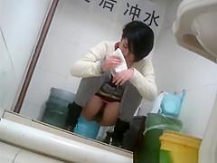 Short hair asian peeing in public toilet