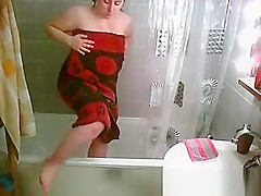 Big natural tits woman showering