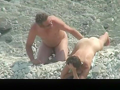 Nude couple spied in rocky beach