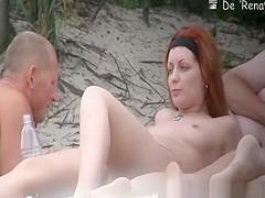 Tattooed nudist redhead with small tits