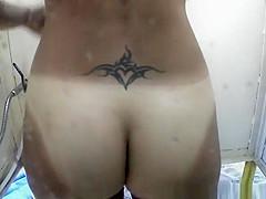 Tattooed nice ass woman in shower cabin