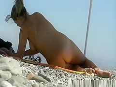 Nudist woman spied reading a magazine