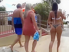 Two chicks with nice asses walking