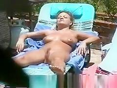 Busty Girl Sunbathing Nude