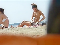 Topless small tanned boobs in beach