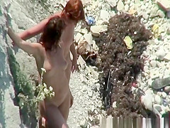 Two nudist women posing for pictures