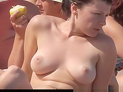 Nice boobs topless chick in the beach