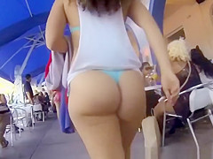 big ass chick wearing blue bikini thong