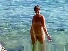Naked on public beach