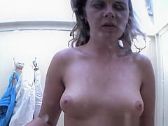 Girl spied in beach cabin showering