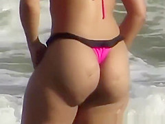 Sexy big ass chick in small pink bikini