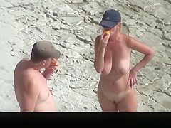 Busty nudist woman with trimmed pussy