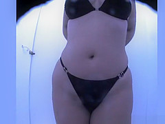 Chubby woman changing her clothes for bikini