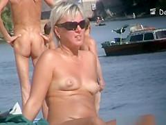 Voyeur at beach films nudists