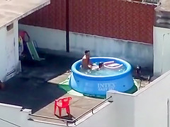 man and woman fucking in the pool