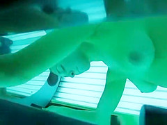 Woman spied in tanning bed