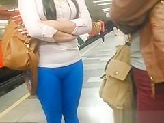Blue leggings brunette girl at metro