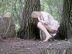 girl lifts her purple skirt and pees