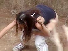 Girl squats next to tree to pee