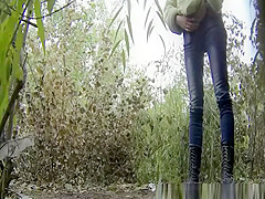two girls peeing outdoor