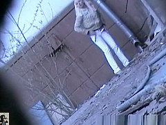 Blonde girl pees outside