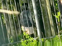 Woman pissing in public park