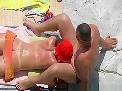 Nudist woman sucks her man cock