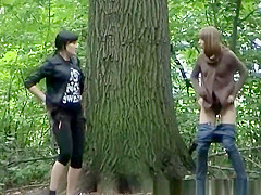 Two girls went to pee outdoors