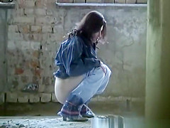 Woman pissing in old building