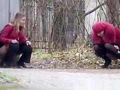 Sexy teens peeing outdoor