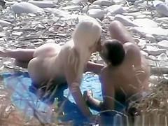 Nudist fucked hard on rocky beach
