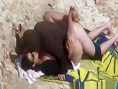 Couple caught fucking in the beach rocks