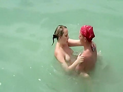Two nudist couples fucking in the water