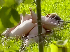 couple naked in the field having sex
