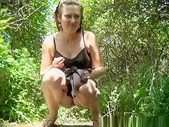 mature woman piss next to bushes
