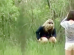 Woman and friend peeing outdoors