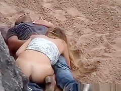 Horny chick riding cock in public beach