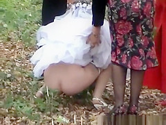 Bride needs help with dress to not piss on it