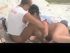 Beach couple spied