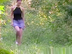 Girl Peeing on Grass