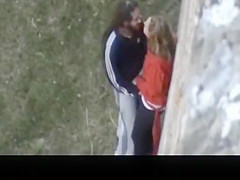 Blowjob against big wall in public
