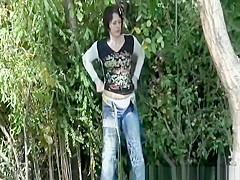 Brunette woman takes a long pee in the forest