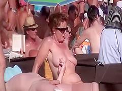 Blowjob in crowded nudist beach