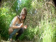 Brunette girl in sunglasses pees