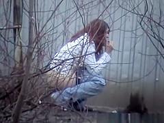 Friends peeing outside