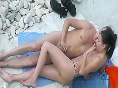Handjob and fingering in rocky beach