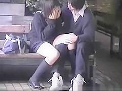 Teen lovers in public place